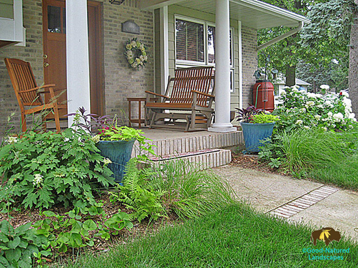 Native plant garden, rain barrels, fountain front door landscape photo