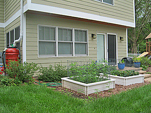 raised bed vegetable garden rain barrels photo
